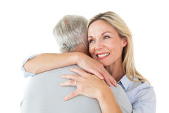 Happy couple standing and hugging Royalty Free Stock Photo