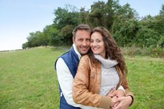 Happy couple standing outside Royalty Free Stock Image