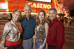 Happy Couple Standing Outside Casino Royalty Free Stock Photography