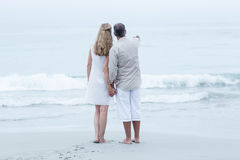 Happy couple standing by the sea and holding hands Royalty Free Stock Photo