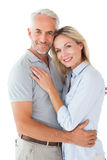 Happy couple standing and smiling at camera Royalty Free Stock Image