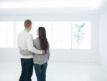 Happy couple standing in their new house Stock Images