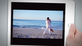 Happy couple standing together on the beach Royalty Free Stock Image