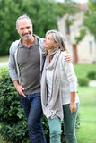 Happy couple standing together in garden Royalty Free Stock Photography