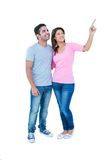 Happy couple standing together and looking away Royalty Free Stock Photography