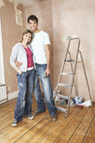 Happy Couple Standing In Unrenovated Room Royalty Free Stock Images