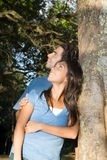 Happy Couple Stare up into the Trees. Vertical Stock Image