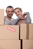 Happy couple starting new life = Royalty Free Stock Image