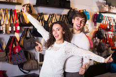 Happy couple in store of handbags Royalty Free Stock Photo