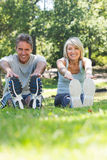 Happy couple stretching in park Royalty Free Stock Photo