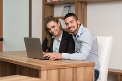 Happy Couple Student In Library With Laptop Stock Images