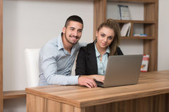 Happy Couple Student In Library With Laptop Royalty Free Stock Photo