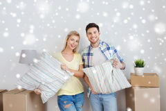 Happy couple with stuff moving to new home Royalty Free Stock Images