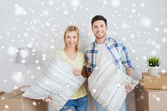 Happy couple with stuff moving to new home Stock Image