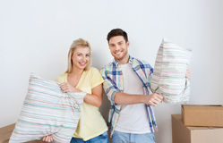 Happy couple with stuff moving to new home Royalty Free Stock Photo