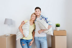 Happy couple with stuff moving to new home Stock Images