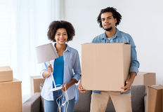 Happy couple with stuff moving to new home Stock Photos
