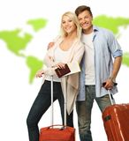 Happy couple with suitcases. And documents against world map Stock Images