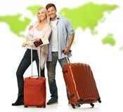 Happy couple with suitcases and documents. Against world map Royalty Free Stock Photos