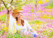 Happy couple in summer garden Stock Photos