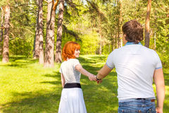 Happy couple in summer park Stock Photos