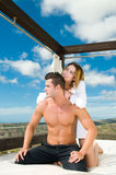 Happy couple in summer on a sun bed Royalty Free Stock Photos