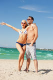 happy couple in sunglasses on the beach Stock Image