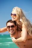 Happy couple in sunglasses on the beach Stock Photo