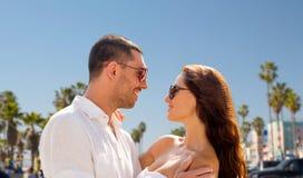 Happy couple in sunglasses over venice beach Royalty Free Stock Photo