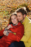 Happy Couple in sunny Autumn Park Stock Photography