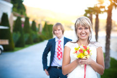 Happy couple in a sunny tropical  park Royalty Free Stock Image