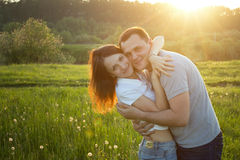 Happy couple at sunset Royalty Free Stock Photo