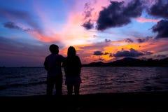 Happy Couple on Sunset Beach Stock Photos