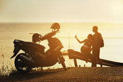 Happy couple sunset sea motorcycle road Royalty Free Stock Photography