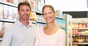 Happy couple in the supermarket. In high quality 4k format stock video
