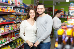Happy couple in a supermarket Royalty Free Stock Image