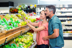 Happy couple at the supermarket Stock Photos