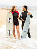 Happy couple with surf boards Stock Images