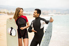 Happy couple with surf boards Royalty Free Stock Image