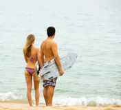 Happy couple with surf boards Stock Photos