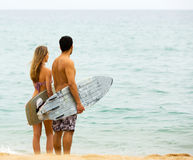 Happy couple with surf boards Stock Image