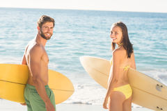 happy couple surfing Royalty Free Stock Image