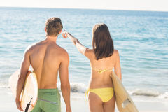 happy couple surfing Royalty Free Stock Photography
