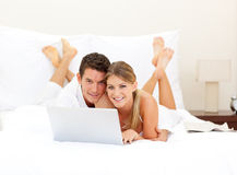 Happy couple surfing the internet Royalty Free Stock Images