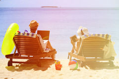 Happy couple surfing the net and enjoy beach Royalty Free Stock Images