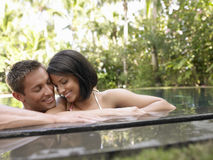 Happy Couple In Swimming Pool Royalty Free Stock Photography