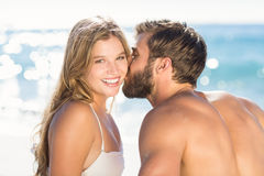 Happy couple in swimsuit embracing Stock Images
