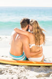 Happy couple in swimsuit embracing Stock Image