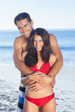 Happy couple in swimsuit hugging Royalty Free Stock Photography