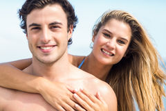 Happy couple in swimsuit looking at camera and embracing Royalty Free Stock Image